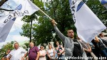 VILNIUS, LITHUANIA - JULY 29: People with banners and flags protesting against migrants on July 29, 2021 in Vilnius, Lithuania. More than 3000 migrants have been intercepted for illegally crossing the Lithuanian border from Belarus. The Lithuanian government has accused the President of Belarus, Alexander Lukashenko, of illegally allowing refugees from the Middle East trying to reach Europe to pass through itsborders. (Photo by Paulius Peleckis/Getty Images)
