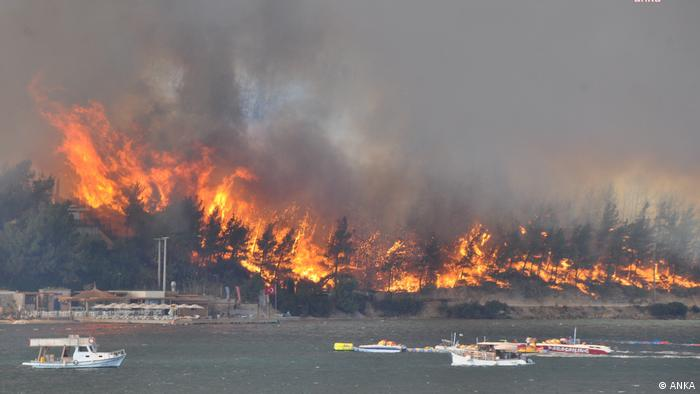 A wildfire blazes in Turkey, some boats are in the water