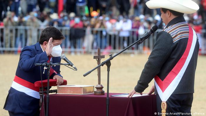 Peru's President Pedro Castillo, right, takes the oath of office of his Prime Minister Guido Bellido, during a symbolic swearing-in ceremony at the site of the 1824 Battle of Ayacucho