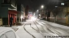 General view of a street covered in snow in Vacaria, Rio Grande do Sul, Brazil July 28, 2021, in this picture obtained from social media. Picture taken July 28, 2021. TWITTER @Lho_nardo via REUTERS THIS IMAGE HAS BEEN SUPPLIED BY A THIRD PARTY. MANDATORY CREDIT. NO RESALES. NO ARCHIVES.