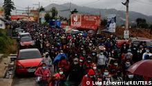Mayan indigenous people leave a road blockade after a protest to demand the resignation of Guatemalan President Alejandro Giammattei and Attorney General Maria Porras, in San Cristobal Totonicapan, Guatemala July 29, 2021. REUTERS/Luis Echeverria