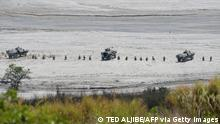 Philippine army and marines next to their armored personnel carriers and tanks maneouver during the live fire exercises