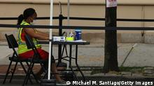 NEW YORK, NEW YORK - JUNE 09: A vaccination worker sits at an empty station at a mobile vaccination site on Flatbush Avenue on June 09, 2021 in the Flatbush neighborhood of the Brooklyn borough of New York City. The rate of coronavirus (COVID-19) vaccinations has dropped since peaking in April, putting in jeopardy the goal of having 70 percent of adults receive at least one dose of a coronavirus vaccine by July 4 set by U.S. President Joe Biden. Centers for Disease Control and Prevention (CDC) data shows 63.7 percent of Americans over the age of 18 have received a first dose of a vaccine and 53 percent have been fully vaccinated. (Photo by Michael M. Santiago/Getty Images)
