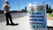 LOS ANGELES, CALIFORNIA - JUNE 25: A sign is posted outside a COVID-19 vaccination clinic at Roosevelt Park in South Los Angeles on June 25, 2021 in Los Angeles, California. St. John's Well Child and Family Center is administering COVID-19 vaccines across South L.A. in a broad effort to bring vaccines to minority communities. (Photo by Mario Tama/Getty Images)