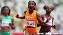 Tokyo 2020 Olympics - Athletics - Women's 100m - Round 1 - OLS - Olympic Stadium, Tokyo, Japan - July 30, 2021. Marie Josee Ta Lou of Ivory Coast reacts after competing and finishing first in Heat 4 REUTERS/Aleksandra Szmigiel