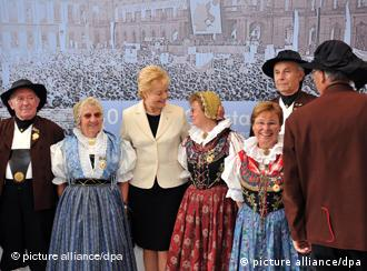 Steinbach and German refugees in traditional costumes