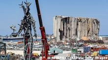 This picture taken on July 28, 2021 shows a view of a 25-metre-tall steel sculpture dubbed The Gesture by Lebanese artist Nadim Karam, made from debris resulting from the aftermath of the blast at the port of Lebanon's capital Beirut that took place on August 4, 2020, hanging from a crane at the site of the blast at the port near the now-iconic damaged grain silos. - - RESTRICTED TO EDITORIAL USE - MANDATORY MENTION OF THE ARTIST UPON PUBLICATION - TO ILLUSTRATE THE EVENT AS SPECIFIED IN THE CAPTION (Photo by JOSEPH EID / AFP) / RESTRICTED TO EDITORIAL USE - MANDATORY MENTION OF THE ARTIST UPON PUBLICATION - TO ILLUSTRATE THE EVENT AS SPECIFIED IN THE CAPTION / RESTRICTED TO EDITORIAL USE - MANDATORY MENTION OF THE ARTIST UPON PUBLICATION - TO ILLUSTRATE THE EVENT AS SPECIFIED IN THE CAPTION (Photo by JOSEPH EID/AFP via Getty Images)