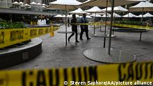 SYDNEY, AUSTRALIA - JULY 23: A man walks past caution tape blocking an eating area during lockdown in Sydney, Australia, Friday, July 23, 2021. NSW's top doctor has declared Sydney's virus outbreak a national emergency, after the number of new locally acquired cases in the state spiked to heights not seen since the first wave. One death and 136 new locally acquired cases of COVID-19 were reported on Friday, almost four weeks after Greater Sydney and its surrounds were locked down in a bid to suppress the virus. Steven Saphore / Anadolu Agency