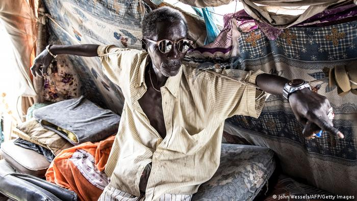Pape Ndiaye (66), an old waste picker and spokesman for the waste pickers association, rests in his makeshift office.