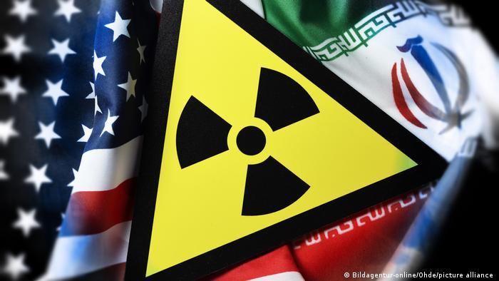 Fahnen von USA und Iran | Radioaktivitaet-Warnschild| Symbolbild
