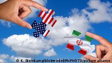 zwei Haende halten jeweils ein Puzzleteil von der USA und dem Iran vor blauem Himmel, Composing | two hand with pieces of puzzles of USA and Iran, Composing
