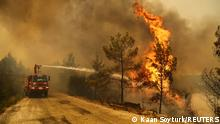30.07.21 *** A firefighter extinguishes a forest fire near the town of Manavgat, east of the resort city of Antalya, Turkey, July 30, 2021. REUTERS/Kaan Soyturk