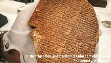 28.07.21 *** This photo provided by Immigration and Customs Enforcement on Wednesday, July 28, 2021, shows a portion of the Epic of Gilgamesh that was looted from Iraq and sold for $1.6 million to Hobby Lobby for display in the Museum of the Bible. A federal judge in New York has approved the forfeiture of the 3,500-year-old clay tablet. (Immigration and Customs Enforcement-ICE via AP)