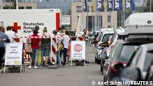 People queue in their cars at a a drive-in vaccination center against the coronavirus disease (COVID-19) in Berlin, Germany, July 17, 2021. REUTERS/Axel Schmidt