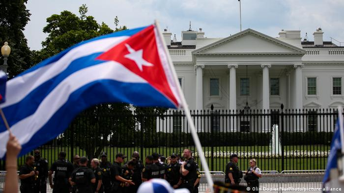 A person waves a Cuban flag in front of the White House during a July 26 demonstration in support of protesters in Cuba