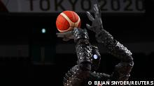 Tokyo 2020 Olympics - Basketball - Women - Group C - Belgium v Puerto Rico - Saitama Super Arena, Saitama, Japan - July 30, 2021. Japanese basketball robot shoots the basketball during half time REUTERS/Brian Snyder SEARCH OLYMPICS DAY 8 FOR TOKYO 2020 OLYMPICS EDITOR'S CHOICE, SEARCH REUTERS OLYMPICS TOPIX FOR ALL EDITOR'S CHOICE PICTURES. TPX IMAGES OF THE DAY