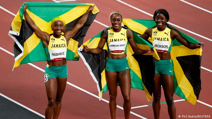 Jamaican trio Elaine Thompson-Herah of Jamaica, Shelly-Ann Fraser-Pryce and Shericka Jackson celebrateafter the 100m final in Tokyo