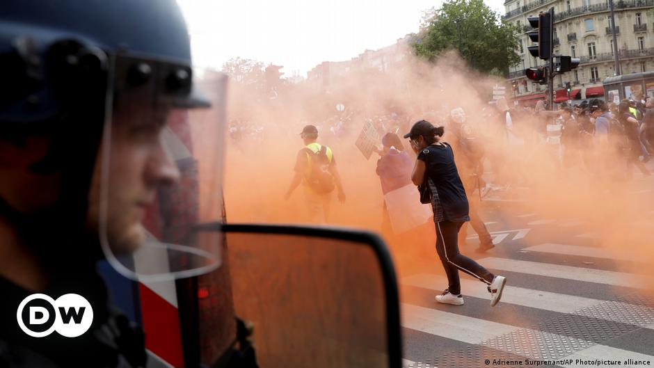 French police clash with protesters over health pass requirement