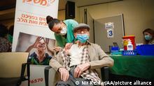 TEL AVIV, ISRAEL - DECEMBER 31: Nurse Edna Gabay injects Pfizer-BioNTech's coronavirus (COVID-19) vaccine to 100 years old Yaakov Haimovic at an elderly home in Ramat Aviv Neighborhood in Tel Aviv Israel on December 31, 2020. Nir Keidar / Anadolu Agency