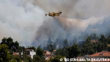 A firefighting airplane makes its way to combat the wildfire near the village of Rodopoli, north of Athens, Greece, July 27, 2021. REUTERS/Costas Baltas