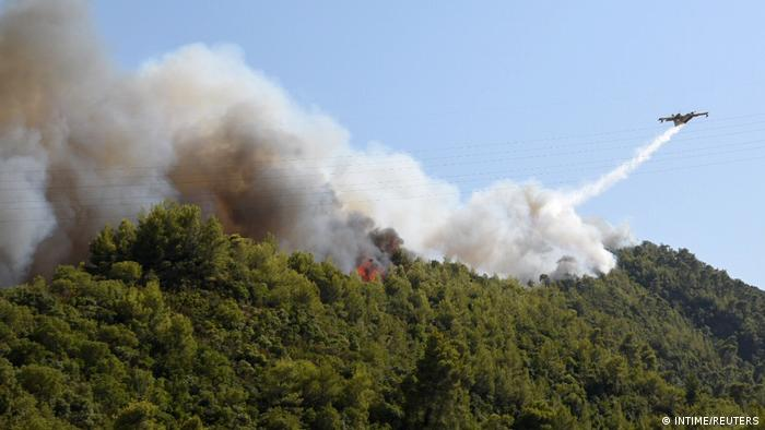 Water dropping aircraft fight fires in the village of Labiri, near Patras, Greece.