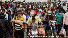 Migrant people and workers get off from a ferry as they are returning to the capital city after government has decided to reopen exports industries including garment factories amid countywide lockdown at Mawa ferry terminal in Munshiganj, Bangladesh, August 1, 2021. REUTERS/Mohammad Ponir Hossain