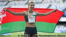 (190712) -- NAPLES, July 12, 2019 () -- Krystsina Tsimanouskaya of Belarus celebrates after the final of Women's 200m of Athletics at the 30th Summer Universiade in Naples, Italy, July 11, 2019. Tsimanouskaya won the gold medal with 23.00 seconds. (/Zheng Huansong)