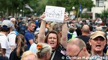 A protester holds a sign reading Freedom at a protest against government measures to curb the spread of coronavirus disease (COVID-19) in Berlin, Germany August 1, 2021. REUTERS/Christian Mang