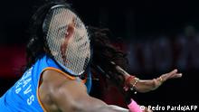 India's P. V. Sindhu hits a shot to China's He Bingjiao in their women's singles badminton bronze medal match during the Tokyo 2020 Olympic Games at the Musashino Forest Sports Plaza in Tokyo on August 1, 2021. (Photo by Pedro PARDO / AFP)