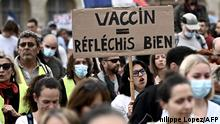 Demonstrators hold up banners and placards, one of which reads as 'vaccine - think hard', during a national day of protest against the compulsory Covid-19 vaccination for certain workers and the compulsory use of the health pass called for by the French government in Bordeaux, south-western France on July 31, 2021. (Photo by Philippe LOPEZ / AFP)