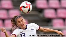 United States' Alex Morgan goes for a header during a women's semifinal soccer match against Canada at the 2020 Summer Olympics, Monday, Aug. 2, 2021, in Kashima, Japan. (AP Photo/Andre Penner)