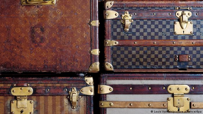 Four Louis Vuitton suitcases stacked atop each each