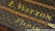 View of a vintage trunk displayed at the bag workshop of luxury brand Louis Vuitton, part of France-based luxury goods company LVMH Moet Hennessy Louis Vuitton SA, in Asnieres-sur-Seine near Paris on June 15, 2013. AFP PHOTO / MIGUEL MEDINA (Photo credit should read MIGUEL MEDINA/AFP via Getty Images)