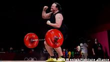 Laurel Hubbard of New Zealand celebrates after a lift in the women's 87kg weightlifting event at the 2020 Summer Olympics, Monday, Aug. 2, 2021, in Tokyo, Japan. (AP Photo/Seth Wenig)