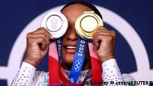Tokyo 2020 Olympics - Gymnastics - Artistic - Women's Floor Exercise - Medal Ceremony - Ariake Gymnastics Centre, Tokyo, Japan - August 2, 2021. Rebeca Andrade of Brazil poses with her medals in front of the olympic rings. REUTERS/Lindsey Wasson