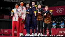 From left, Silver medalists Li Jun Hui and Liu Yu Chen of China, Gold medalists Taiwan's Wang Chi-Lin and Lee Yang and Bronze medalists Aaron Chia and Soh Wooi Yik of Malaysia, celebrate during medal ceremony of men's double Badminton match at the 2020 Summer Olympics, Saturday, July 31, 2021, in Tokyo, Japan. (AP Photo/Dita Alangkara)