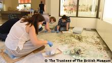 The Museum team, conservator and student volunteers retrieve fragments of broken glass vessels from amongst the shattered glass from the display case and nearby windows, at the Archaeological Museum, AUB . Courtesy of the AUB Office of Communications and Archaeological Museum