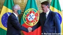 Handout picture released by Brazilian Presidency showing Portugal's President Marcelo Rebelo de Sousa (L) and Brazilian President Jair Bolsonaro during a welcoming ceremony at Alvorada palace in Brasilia, on August 2, 2021, within the framework of a 4-days official visit. (Photo by MARCOS CORREA / BRAZILIAN PRESIDENCY / AFP) / RESTRICTED TO EDITORIAL USE - MANDATORY CREDIT 'AFP PHOTO / BRAZIL'S PRESIDENCY PRESS OFFICE - MARCOS CORREA' - NO MARKETING - NO ADVERTISING CAMPAIGNS - DISTRIBUTED AS A SERVICE TO CLIENTS
