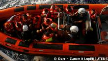 A rigid-hulled inflatable boat (RHIB) from the German NGO migrant rescue ship Sea-Watch 3 returns to the ship after rescuing twelve migrants from a wooden boat in international waters north of Libya, in the western Mediterranean Sea, August 2, 2021. REUTERS/Darrin Zammit Lupi