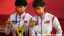 Gold medallists China's Bao Shanju (L) and China's Zhong Tianshi pose with their medals on the podium after the women's track cycling team sprint finals during the Tokyo 2020 Olympic Games at Izu Velodrome in Izu, Japan, on August 2, 2021. (Photo by Greg Baker / AFP) (Photo by GREG BAKER/AFP via Getty Images)