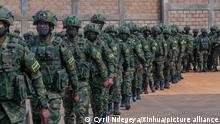 (210711) -- KIGALI, July 11, 2021 (Xinhua) -- Rwandan soldiers wait to board a plane for Mozambique in Kigali, capital city of Rwanda, July 10, 2021. The Rwandan government on Friday started deploying a 1000-member joint force of army and police personnel to Mozambique to support efforts to restore state authority in the latter's restive region. The deployment of the contingent comprised of members of Rwanda Defence Force and the Rwanda National Police to Cabo Delgado, Mozambique's gas-rich province that is under threat of the Islamic State-related armed groups and insurgents, is at the request of the government of Mozambique, the Rwandan government said in a statement on Friday. (Photo by Cyril Ndegeya/Xinhua)