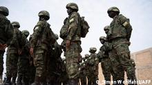 Rwandan soldiers from Rwanda Defence Forces (RDF) and Rwandan policemen prepare to board a Rwandair plane for a military mission to Mozambique at Kanombe airport, Kigali, Rwanda on July 10, 2021. - The mission, which includes a contingent of 1,000 soldiers and police, is aimed at helping the country fight extremist militants who are wreaking havoc in the gas-rich north of the nation, at the request of the Mozambican government. (Photo by Simon Wohlfahrt / AFP)