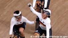 Germany's Franziska Brausse (R) celebrates with her teammates after setting the new world record during the women's track cycling team pursuit finals during the Tokyo 2020 Olympic Games at Izu Velodrome in Izu, Japan, on August 3, 2021. (Photo by Odd ANDERSEN / AFP) (Photo by ODD ANDERSEN/AFP via Getty Images)
