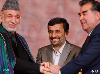 Iranian President Mahmoud Ahmadinejad shakes hands with his counterparts from Tajikistan Emomali Rakhmon and Afghanistan Hamid Karzai