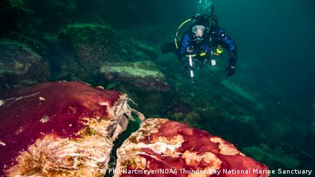 Scientist dives to the lake floor at Lake Huron's Middle Island Sinkhole