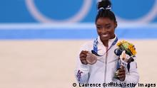 TOKYO, JAPAN - AUGUST 03: Simone Biles of Team United States poses with the bronze medal during the Women's Balance Beam Final medal ceremony on day eleven of the Tokyo 2020 Olympic Games at Ariake Gymnastics Centre on August 03, 2021 in Tokyo, Japan. (Photo by Laurence Griffiths/Getty Images)