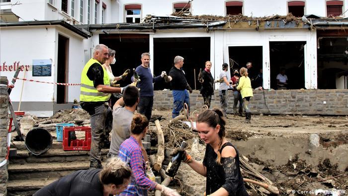 Germany - Rescuers sift through debris in the Eifel