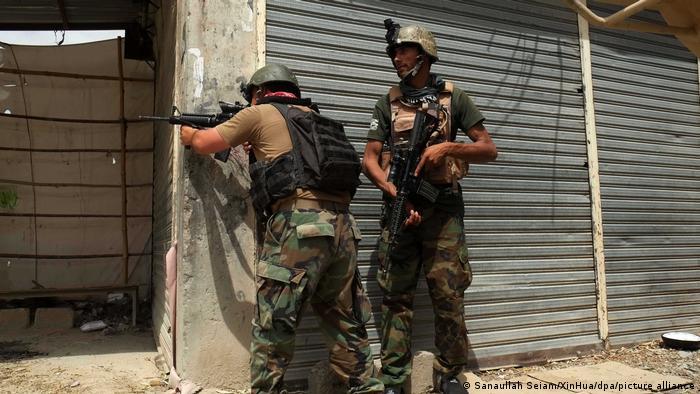 Afghan forces battle the Taliban in fierce streetfighting