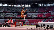 Tokyo 2020 Olympics - Athletics - Women's Long Jump - Final - Olympic Stadium, Tokyo, Japan - August 3, 2021. Malaika Mihambo of Germany in action REUTERS/Aleksandra Szmigiel SEARCH OLYMPICS DAY 12 FOR TOKYO 2020 OLYMPICS EDITOR'S CHOICE, SEARCH REUTERS OLYMPICS TOPIX FOR ALL EDITOR'S CHOICE PICTURES.TPX IMAGES OF THE DAY.