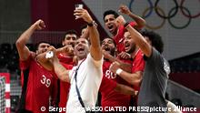 Egypt players celebrate as they won the men's quarterfinal handball match between Germany and Egypt at the 2020 Summer Olympics, Tuesday, Aug. 3, 2021, in Tokyo, Japan. (AP Photo/Sergei Grits)